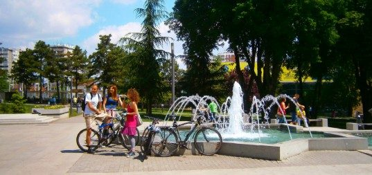 Cyclists in Belgrade city center tazmajdan park at fountain