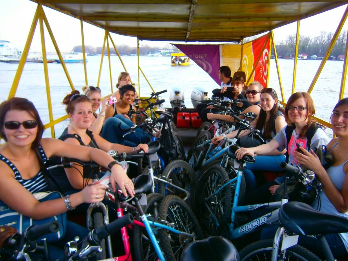 Full boat with bikes crossing the Sava