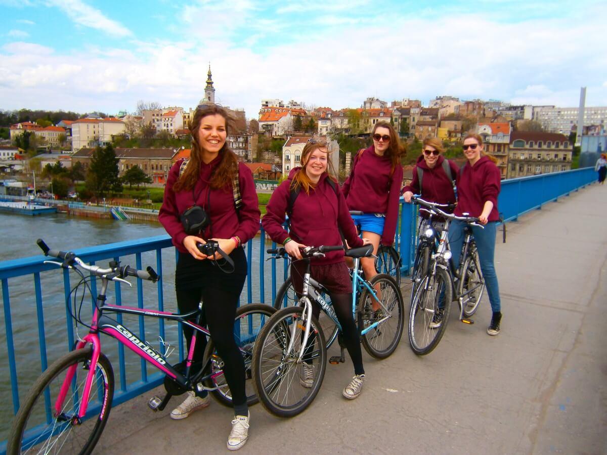 Dutch student girls cycling on Brankov Most in Belgrade