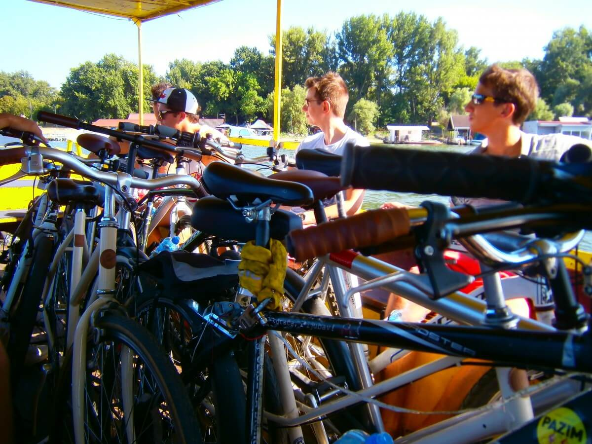 Crossing the Sava river by boat with bikes