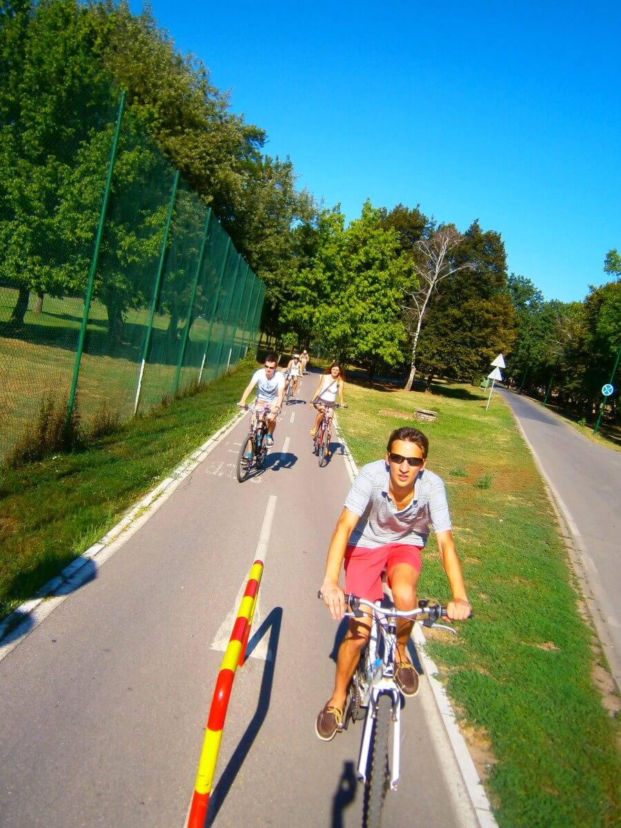 Riding bikes on Belgrade beach island Ada Ciganlija